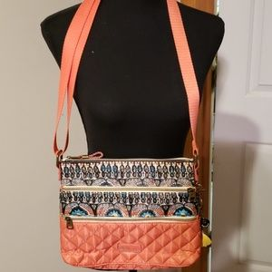 Colorful and functional Sakroots cross body